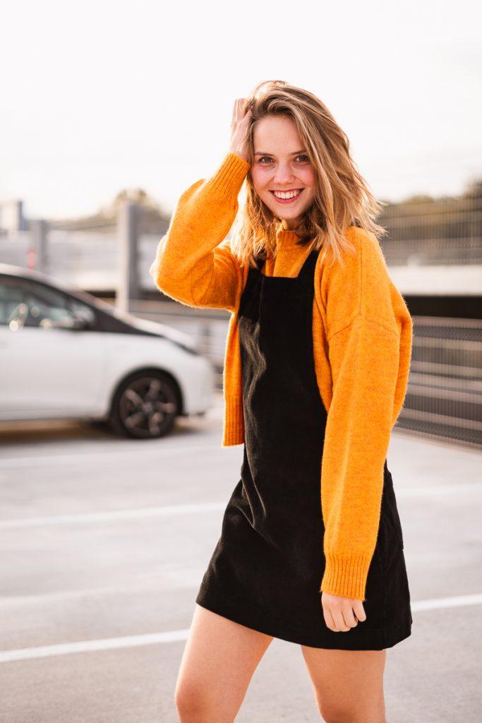 Girl at a parking garage.