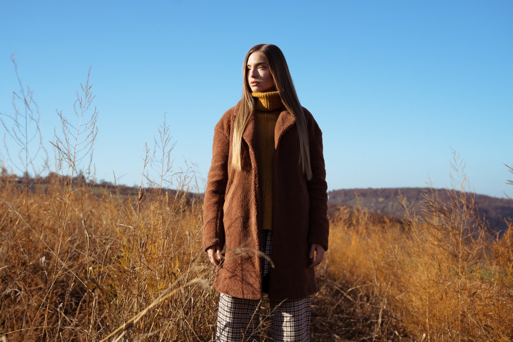 Girl in autumn cloths and in a field